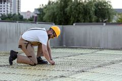 Side view of builder in protective googles and hardhat working. At construction site royalty free stock images