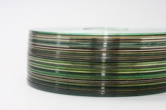 Side view of a bunch of old compact discs Royalty Free Stock Photography