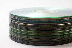 Side view of a bunch of old compact discs Royalty Free Stock Photos