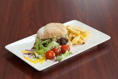 Side view of burger with french fries and salad Royalty Free Stock Photos