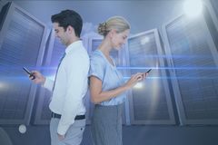 Side view of business colleagues using smart phones at data center Stock Photography