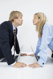 Side view of business couple kissing in office Royalty Free Stock Photography