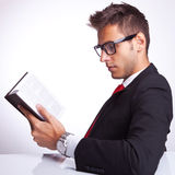Side view of a business man reading a book Royalty Free Stock Photo