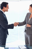 Side view of business people welcoming each other Stock Photo