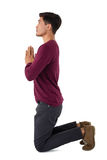 Side view of business praying Royalty Free Stock Image