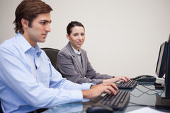 Side view of business team working in their office Royalty Free Stock Images