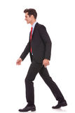 Side view of a business walking forward Stock Photography