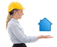 Side view of business woman in builder helmet holding small hous Stock Photo