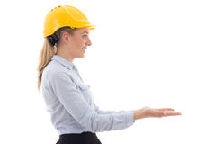 Side view of business woman in builder helmet holding something Royalty Free Stock Photography