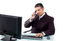Side view of businessman busy on phone Royalty Free Stock Photography