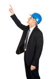 Side view of businessman engineer pointing up Stock Photography