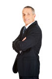 Side view of businessman with folded arms Royalty Free Stock Images