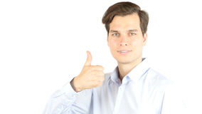 Side view of businessman giving thumb up against a white background Stock Images