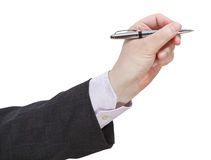 Side view of businessman hand with silver pen Royalty Free Stock Images