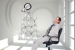 Side view of businessman leaning back in his chair Royalty Free Stock Images