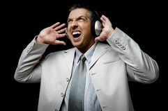 Side view of businessman listening music Stock Images