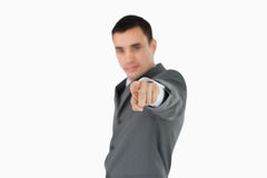 Side view of businessman pointing towards camera Stock Image