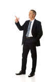 Side view businessman pointing upwards Stock Photography