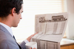 Side view of businessman reading newspaper Stock Photography