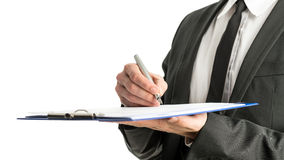 Side view of a businessman signing legal papers on a map with fo Stock Images