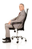 Side view of businessman sitting on armchair Royalty Free Stock Image