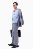 Side view of businessman with suitcase Stock Photos