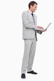 Side view of businessman working on his laptop Stock Photo