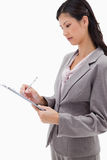 Side view of businesswoman with clipboard Royalty Free Stock Photos