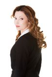 Side view of businesswoman looking at the camera Stock Photo