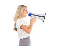 Side view of a businesswoman with megaphone Stock Photos