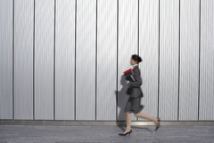 Side View Of Businesswoman Running Outdoors Stock Photos