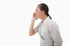 Side view of a businesswoman shouting Royalty Free Stock Photo