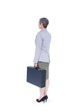 Side view of businesswoman stranding with suitcase Stock Photography