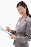 Side view of businesswoman taking notes Royalty Free Stock Photography
