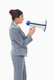 Side view of businesswoman using megaphone Stock Photo