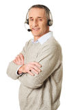 Side view of call center man with folded arms Royalty Free Stock Photos