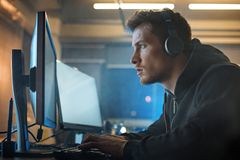Serious software specialist typing in gadget stock images