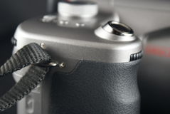 Side view of camera. Closeup to press button of digital camera Royalty Free Stock Photos