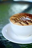 Side view of cappuccino coffee cup Royalty Free Stock Photography