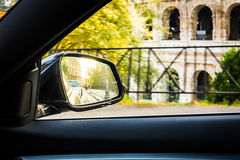Side view car mirror in sunset ancient city Rome panorama Royalty Free Stock Photo