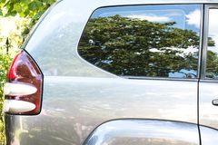Side view of a car parked on the street in summer sunny day. Mock-up for sticker or decals stock photos