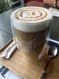 Side view Caramel latté with radial pattern stock photography