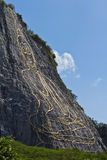 Side view of carved buddha image on the cliff royalty free stock photography