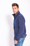Side view of a casual fashion man royalty free stock photo