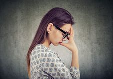 Worried young woman in depression stock image