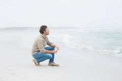 Side view of a casual young man relaxing at beach Royalty Free Stock Photography