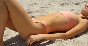 Side view of Caucasian woman in hat relaxing on the beach 4k. Side view of Caucasian woman in hat relaxing on the beach. She is asleep 4k stock footage