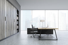 Side view of a CEO office with wooden doors and a bookcase Stock Photos