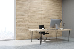 Side view of CEO working desk in office with wooden panels Royalty Free Stock Photography
