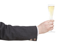 Side view of champagne glass in businessman hand Royalty Free Stock Images
